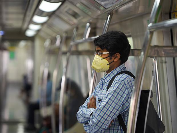 A passenger wearing a face mask travels in a metro train on Blue line. Photo: PTI