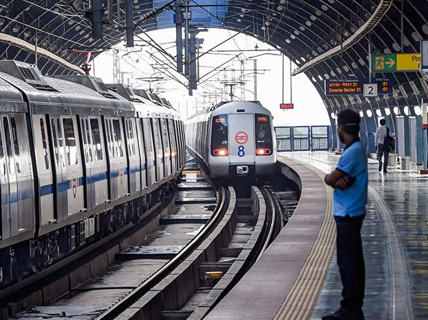 A metro train arrives at a platform. Photo: PTI
