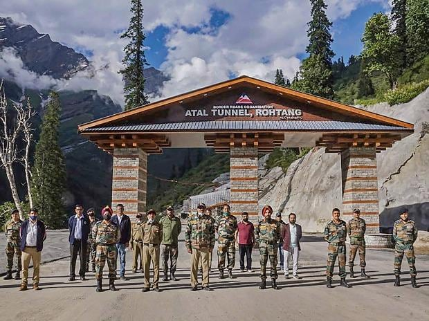 BRO DG Lt Gen Harpal Singh with others poses for photographs during his visit to the newly constructed 'Atal tunnel' for inspection and review work, ahead of its inauguration, in Manali
