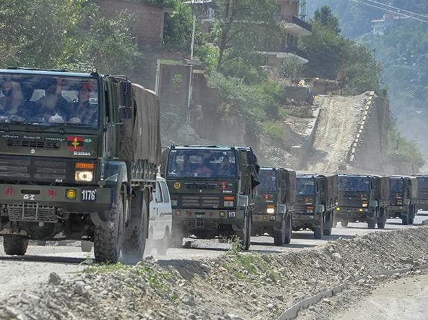 An army convoy carrying military material on its way to Ladakh amid border tension with China, at Manali-Leh highway.  Photo: PTI