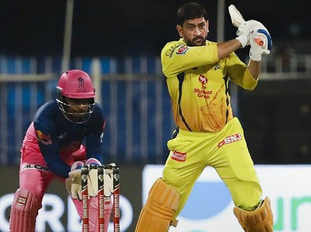 In IPL 2020, MS Dhoni playing a shot during CSK vs RR match at Sharjah Stadium