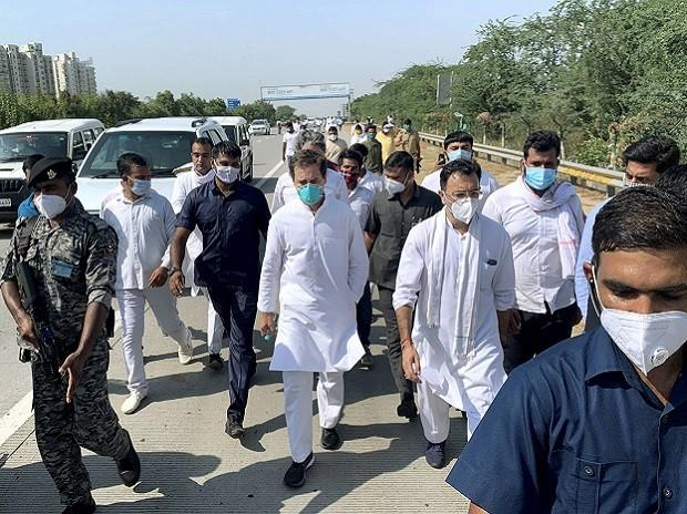 Noida: Former Congress President Rahul Gandhi with party leaders marches along the Yamuna Expressway to meet the family of the 19-year-old Dalit rape victim in Hathras, after their vehicles were stopped by the authorities, in Noida. (PTI Photo/Ravi C