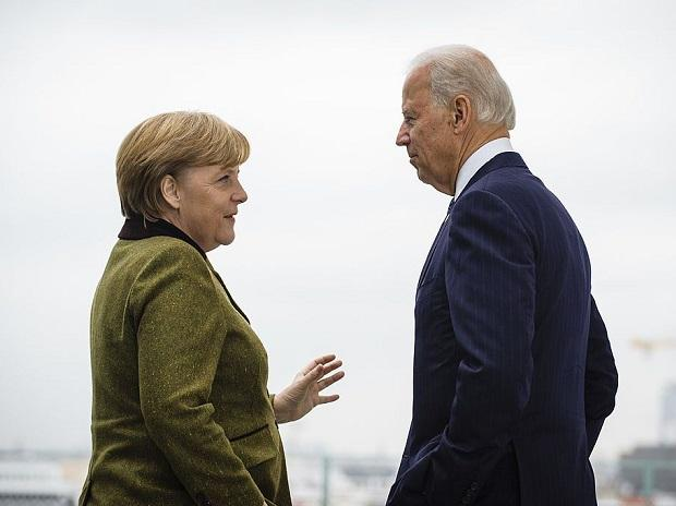 German Chancellor Angela Merkel speaks with US Vice President Joe Biden at the start of their meeting at the Chancellery on February 01, 2013 in Berlin. Photo: Getty Images