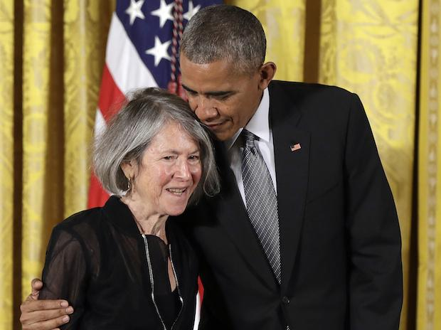 In this Thursday, Sept. 22, 2016 file photo, President Barack Obama embraces poet Louise Gluck before awarding her the 2015 National Humanities Medal during a ceremony in the East Room of the White House, in Washington
