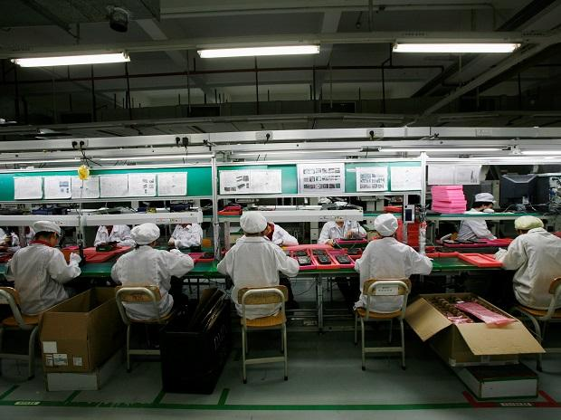 Workers are seen inside a Foxconn factory in the township of Longhua in the southern Guangdong province, China. Photo: Reuters