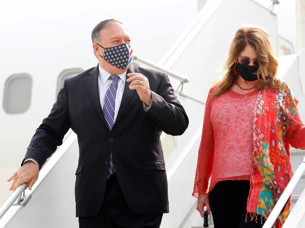 Secretary of State Mike Pompeo, and his wife Susan disembark from an aircraft upon their arrival at the airport in New Delhi