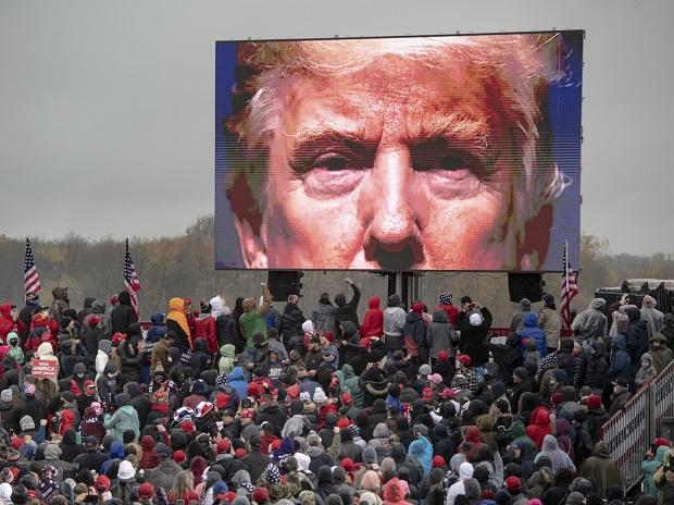 Supporters of President Donald Trump watch a video screen showing his face during a campaign event in Lansing. (Photo: AP)