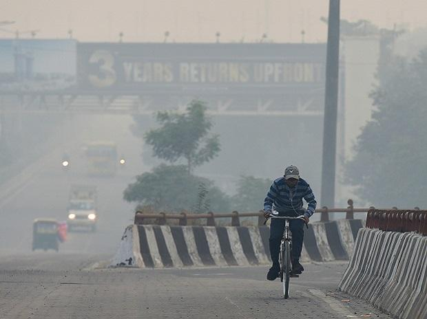 Noida: Vehicles ply amid hazy weather condition, in Noida, Sunday, Nov.1, 2020. (PTI Photo/Manvender Vashist)