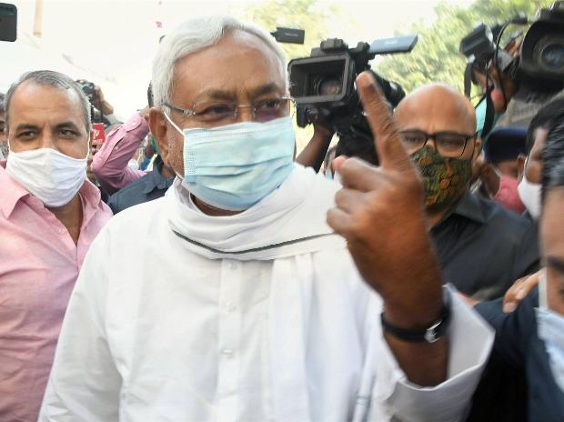 Bihar Chief Minister Nitish Kumar shows finger marked with indelible ink after casting his vote for the second phase of the Bihar Assembly Election