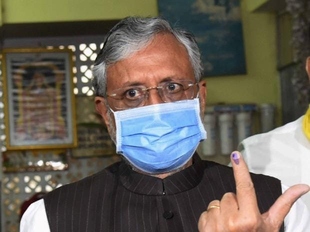 Bihar Deputy CM Sushil Kumar Modi shows his finger marked with ink after casting his vote in Patna
