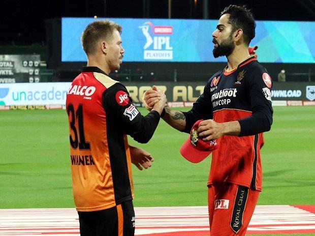 David Warner and Virat Kohli after IPL 2020 eliminator match on Friday