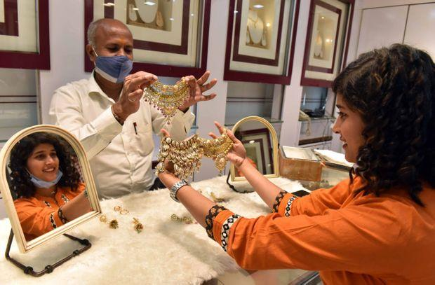 A woman shopping for jewellery on the occasion of Dhanteras at a store in Mumbai. Photo: Kamlesh Pednekar