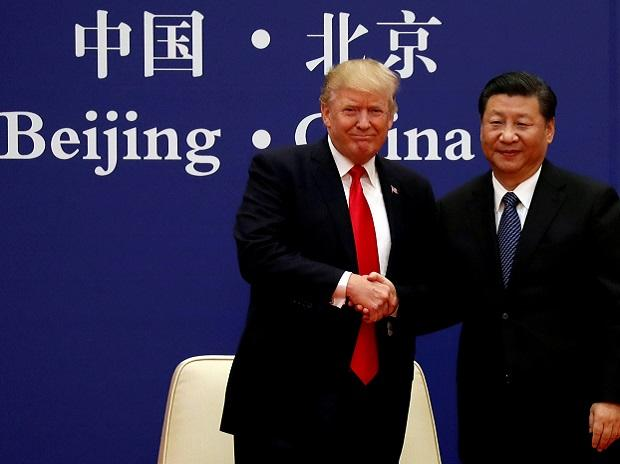 US President Donald Trump and China's President Xi Jinping meet business leaders at the Great Hall of the People in Beijing. Photo: PTI