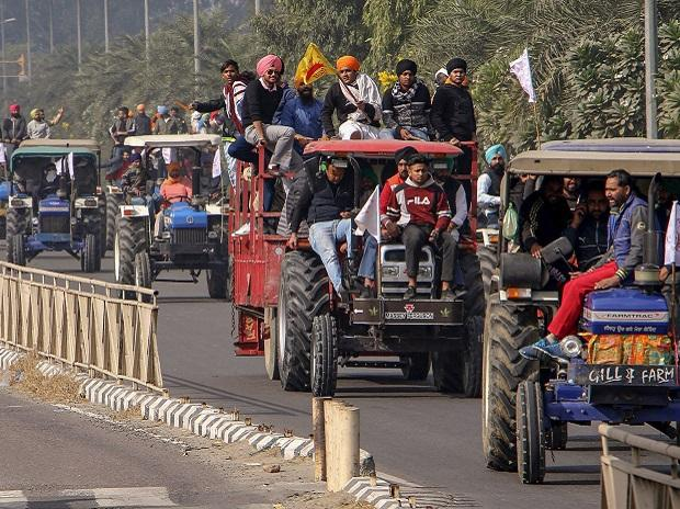 Farmers and their supporters take part in a tractor rally during a protest to support the nationwide strike, called by farmer unions to press for repeal of the Centres Agri laws, in Amritsar, Tuesday, Dec. 8, 2020. (PTI Photo)