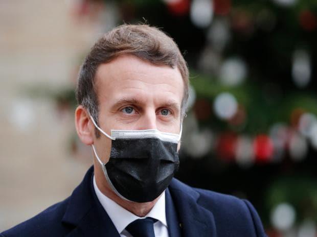 French President Emmanuel Macron reacts as he meets Portuguese Prime Minister Antonio Costa, Wednesday, Dec. 16, 2020 in Paris.  (AP Photo/Francois Mori)
