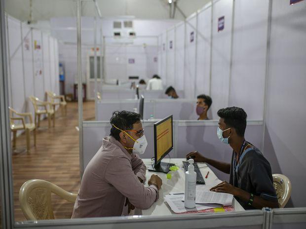 A volunteer registers for a coronavirus vaccine at a hospital in Mumbai