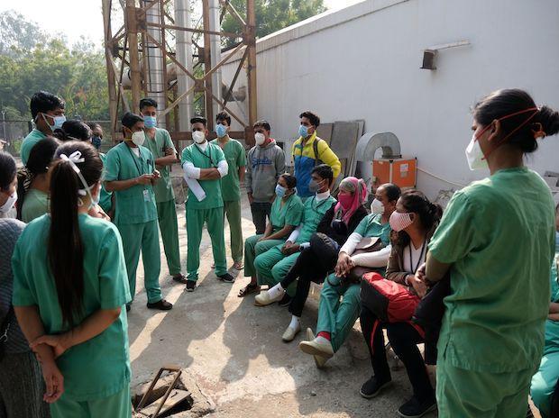 Nursing staff receive a doctor's briefing in New Delhi