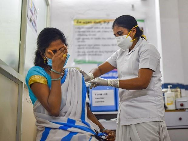 A medic administers the first dose of Covishield vaccine to a frontline worker, after the virtual launch of Covid-19 vaccination drive by Prime Minister Narendra Modi, at a health center in Visakhapatnam, Saturday, Jan. 16, 2021. (PTI Photo)