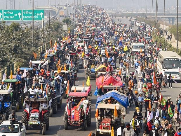 Farmers participate in a tractor rally after breaking police barricades at Singhu border on the occasion of 72nd Republic Day, near Bhalswa landfill site in New Delhi, Tuesday, Jan. 26, (PTI Photo/Shahbaz Khan)