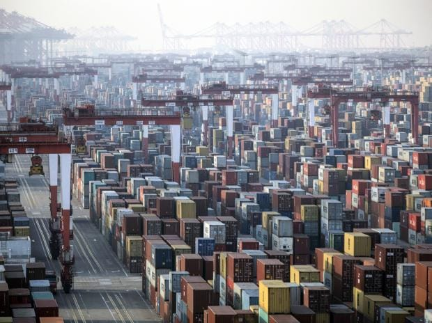 Shipping containers next to gantry cranes at the Yangshan Deepwater Port in Shanghai, China, on Monday, Jan, 11, 2021. Photo: Bloomberg