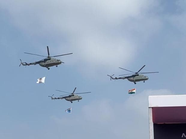 Three Mi-17 helicopters taking part in the flypast at the inauguration of the Aero India-2021