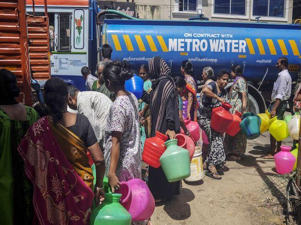 Residents fill pots from a water truck on July 4, 2019, when Chennai became one of the first major cities in the world to run dry