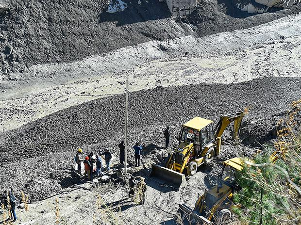 Rescue operations underway near the Rishi Ganga Power Project, a day after a glacier broke off in Joshimath causing a massive flood in the Dhauli Ganga river, in Chamoli district of Uttarakhand. Photo: PTI