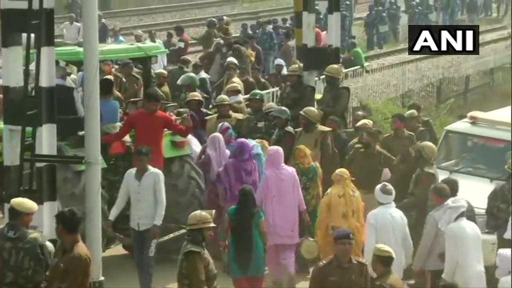 Haryana: Farmers block railway tracks in Palwal as a part of their nationwide 'rail roko' agitation against Farm Laws. Security personnel also present (ANI)
