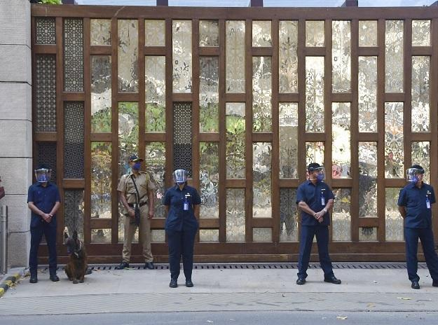 Police personnel stand guard outside industrialist Mukesh Ambais residence Antilla, a day after explosives were found in an abandoned car in its vicinity, in Mumbai on Friday