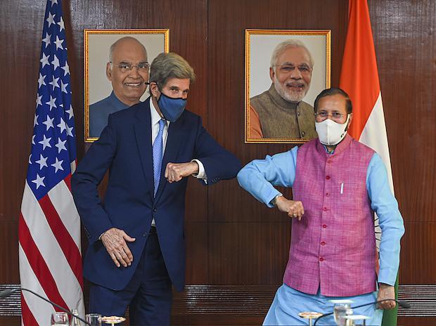 US climate envoy John Kerry and Union Minister Prakash Javadekar exchange greetings during a meeting at Prayvaran Bhawan, in New Delhi   Photo: PTI