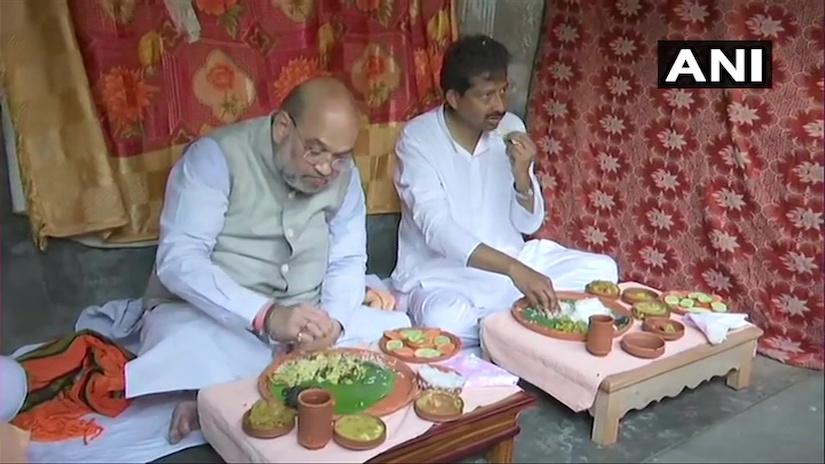 Union Home Minister and BJP leader Amit Shah lunches at the residence of a rickshaw puller who is also a BJP supporter | Photo: ANI