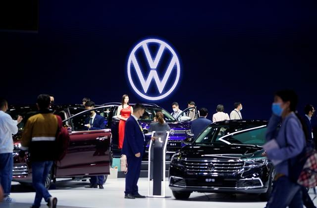 People visit the Volkswagen booth during a media day for the Auto Shanghai show in Shanghai (Photo: Reuters)