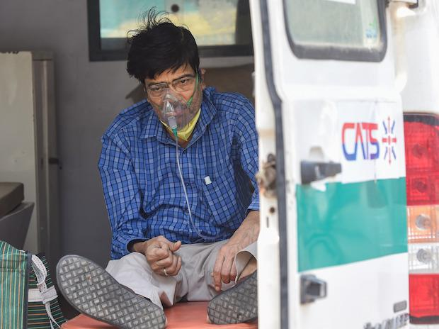 A COVID-19 patient waits in an ambulance outside the LNJP hospital, in New Delhi, Monday, April 26, 2021. (PTI Photo/Manvender Vashist)