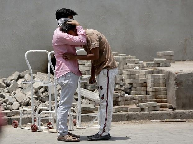 Relatives of a patient grieve outside a Covid-19 hospital in Ahmedabad, Tuesday, April 27, 2021.