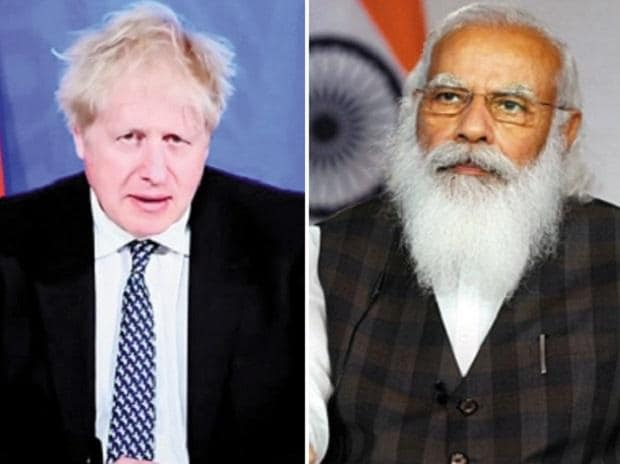 Prime Minister Narendra Modi and his UK counterpart Boris Johnson during the virtual summit on Tuesday. Photo: PTI