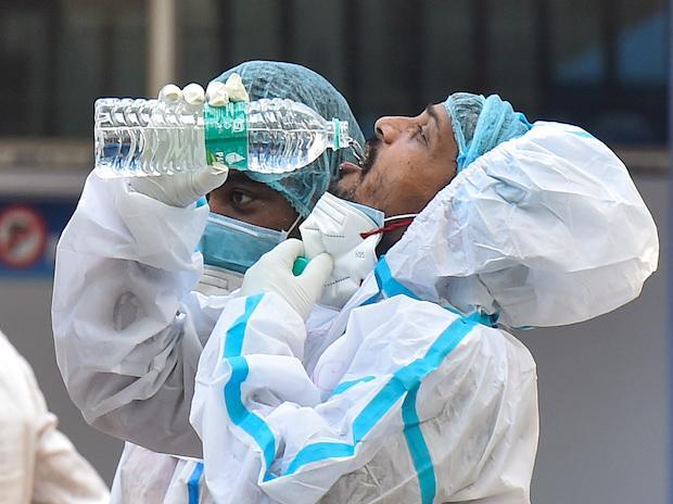 A health worker takes a break at a hospital treating Covid-19 patients in Kolkata on Saturday, May 8, 2021. (PTI Photo/Swapan Mahapatra)