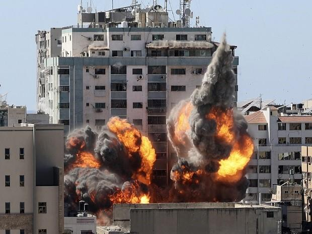 A ball of fire erupts from a building housing various international media, including The Associated Press, after an Israeli airstrike on Saturday, May 15, 2021 in Gaza City. (File Photo: AP/PTI)