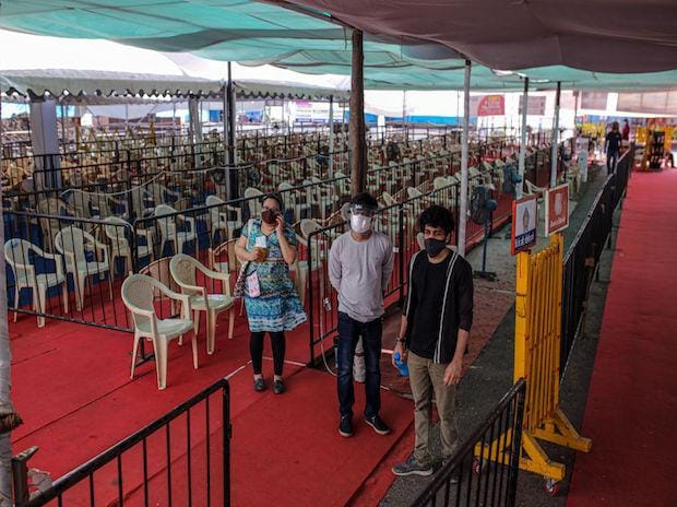 People in a waiting area at Covid-19 vaccination center in the Bombay Kurla Complex. (Photo: Bloomberg)