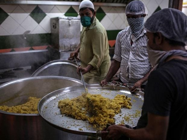 Jobs lost, middle-class Indians line up for rations and 'worry about meals'