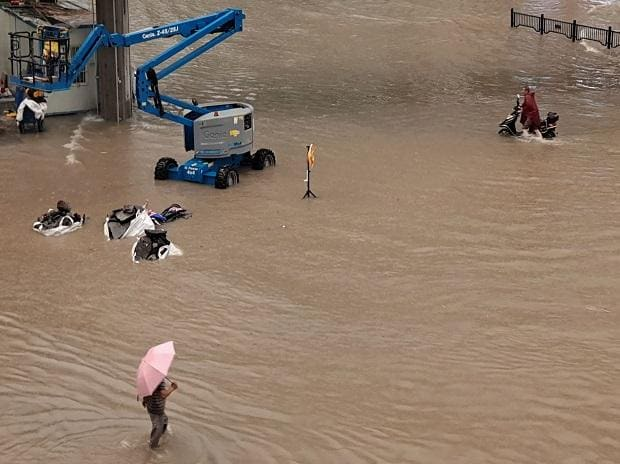 China's 'iPhone city' relocates 100,000 people after record rain, flood
