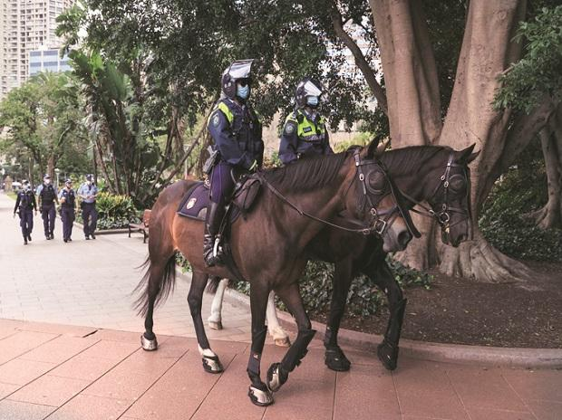 Covid-19 pandemic: Army patrols in Sydney streets; China cases surge