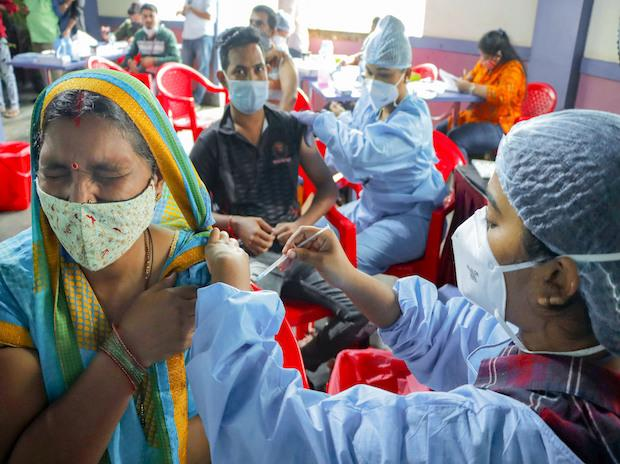 Healthcare workers give Covid-19 vaccine shots to visitors at the Shahaji Raje Sport Complex in Mumbai on Wednesday, September 1, 2021. (PTI Photo)