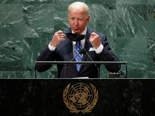 US President Joe Biden takes off his protective face mask worn due to the coronavirus pandemic as he arrives to speak during the 76th Session of the UN General Assembly in New York City (Photo: Reuters)
