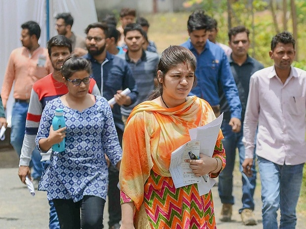 Candidates come out of an exam centres after appearing for the Union Public Service Commission (UPSC) exam, in Jabalpur, on Sunday, June 03, 2018.