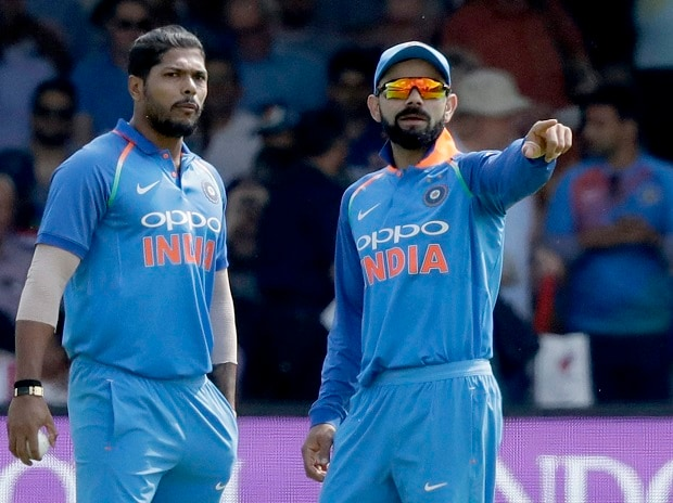India captain Virat Kohli, right, gives instructions next to India's Umesh Yadav during the one day cricket match between England and India at Lord's cricket ground in London