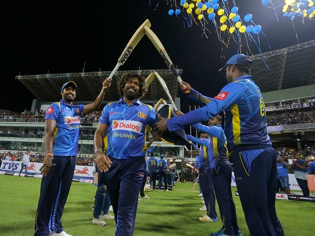 Lasith Malinga is congratulated by his teammates during the last one-day international cricket match of his career