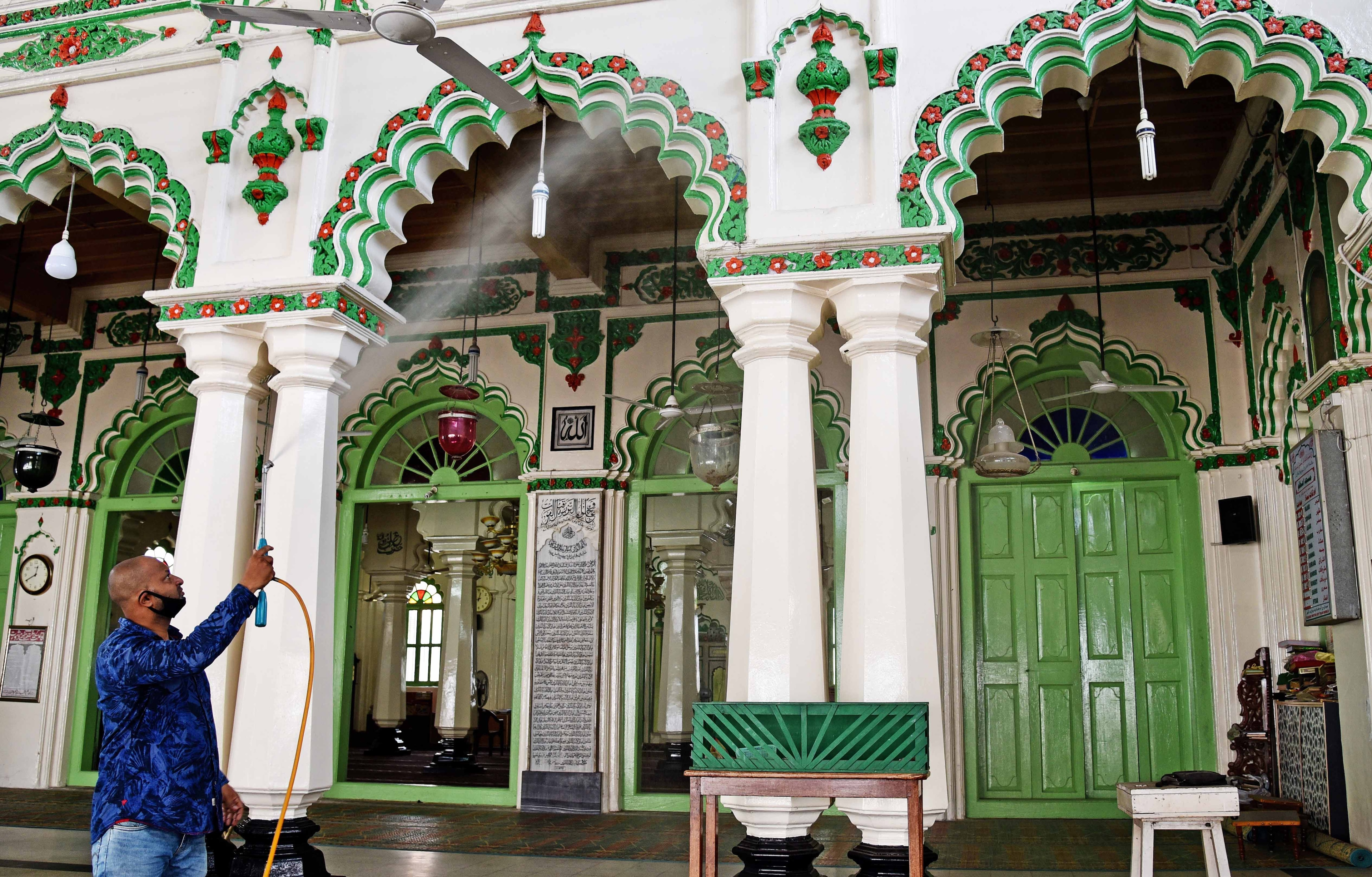 A worker sanitizing a Mosque at Shivajinagar, ahead of its reopening on 8th June as per the guidelines of the Government during coronavirus lockdown, in Bengaluru on Saturday.