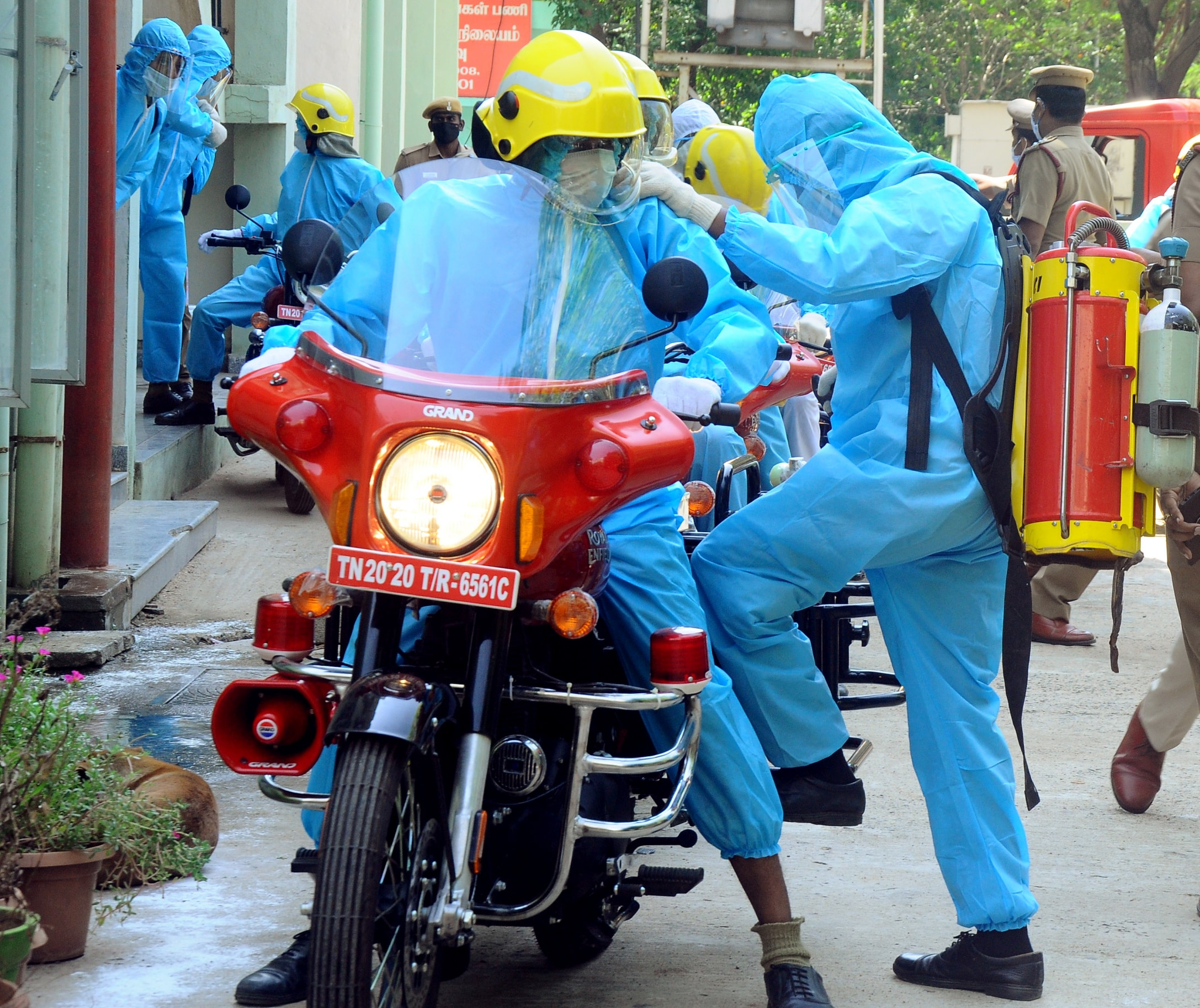 Firefighters wearing PPE kits ride bikes as around 60 of them who were on duty during Covid-19 pandemic return to station after successfully recovering in Chennai