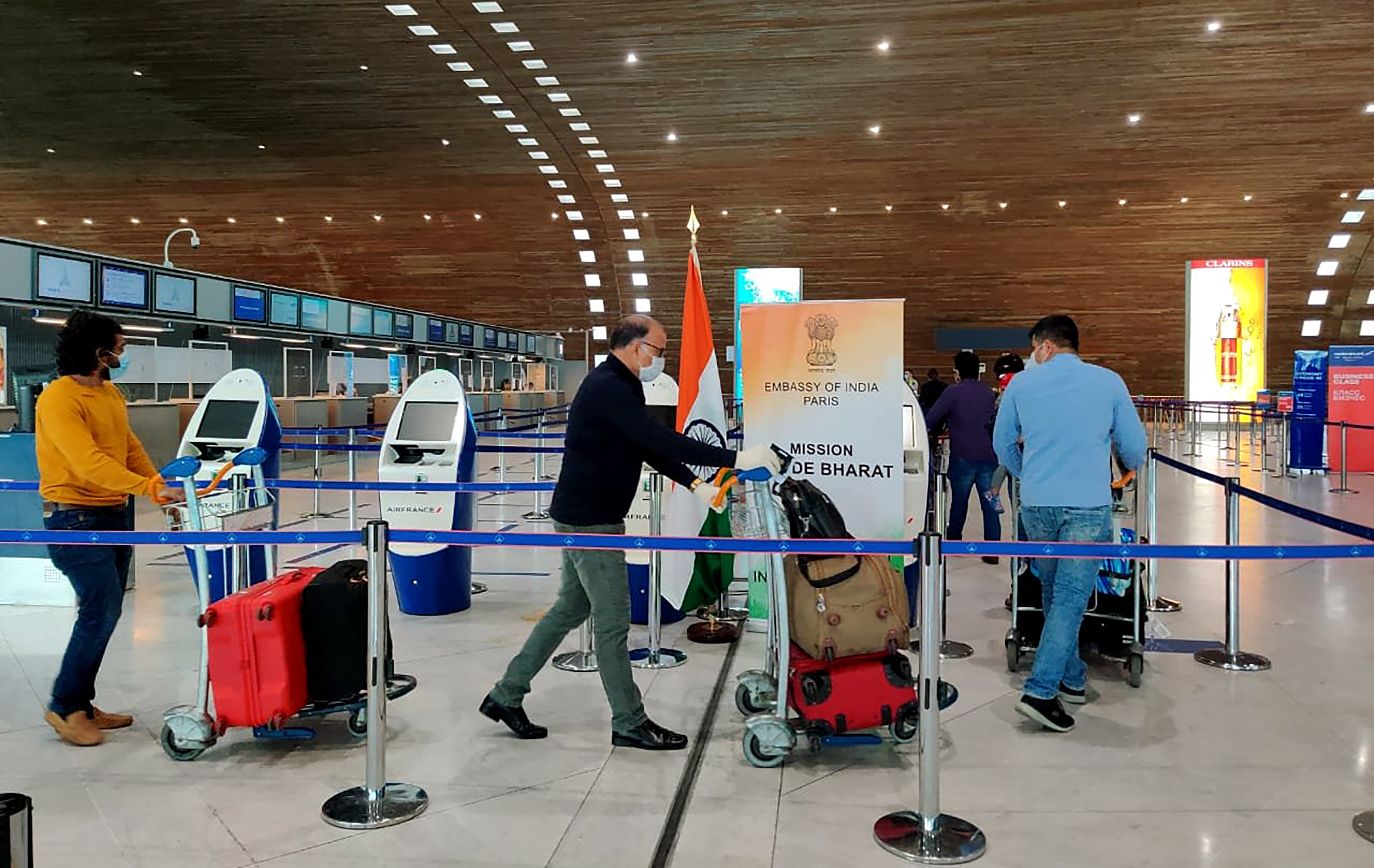 Stranded Indian nationals arrive to board a special Air India flight from Paris Charles de Gaulle airport for Kochi, in Paris