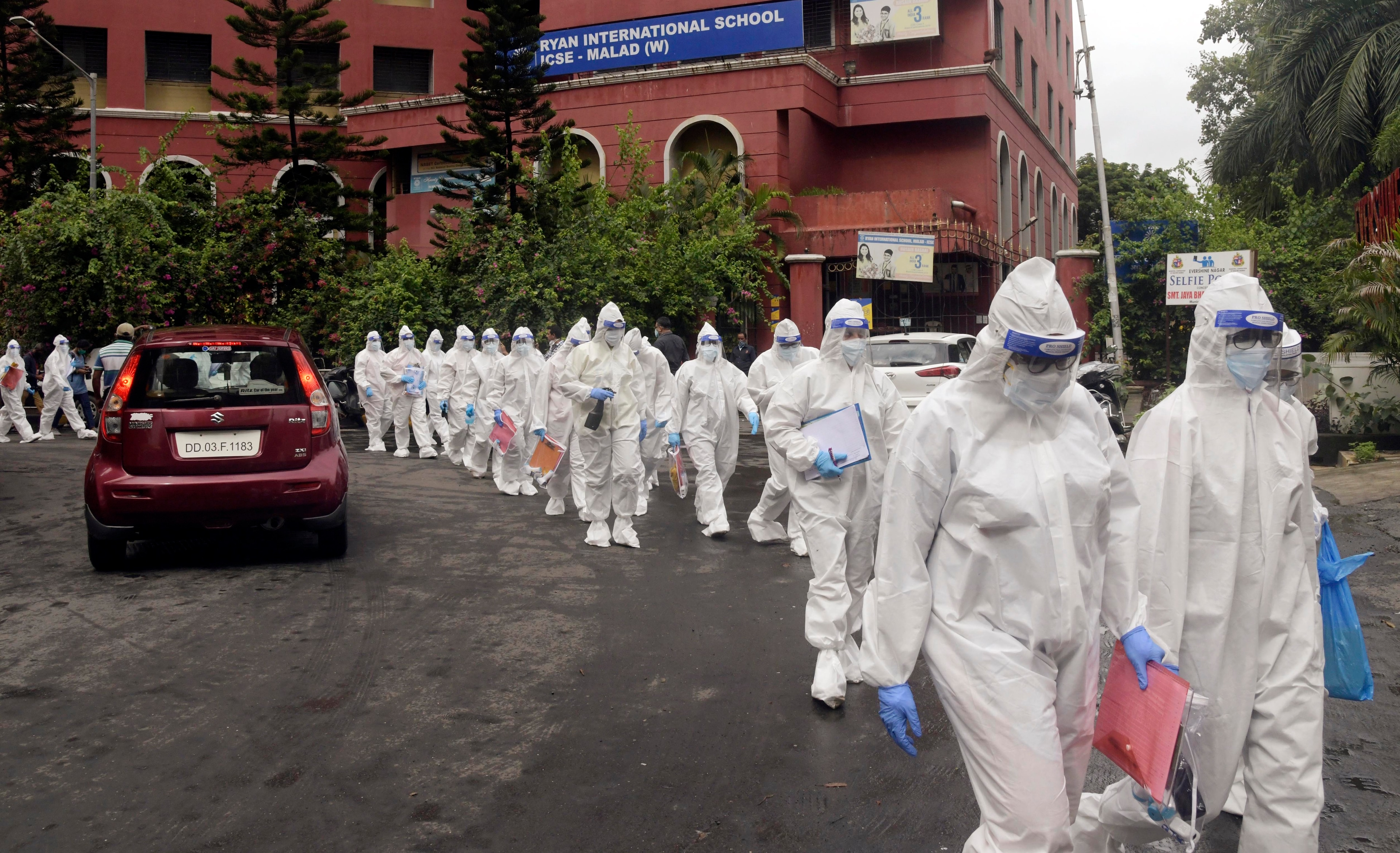 Medical students of various government hospitals wearing PPE suite going for the thermal screening of people in colonies which are declared as Covid-19 contaminated zones, in Mumbai.